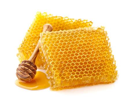 Nids d'abeilles avec une cuillère en bois Banque d'images - 66417178