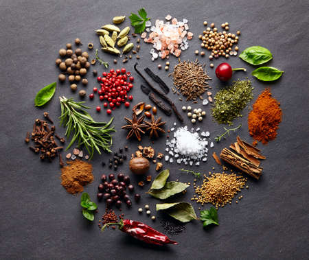 Spices with herbs on a graphite board Stok Fotoğraf