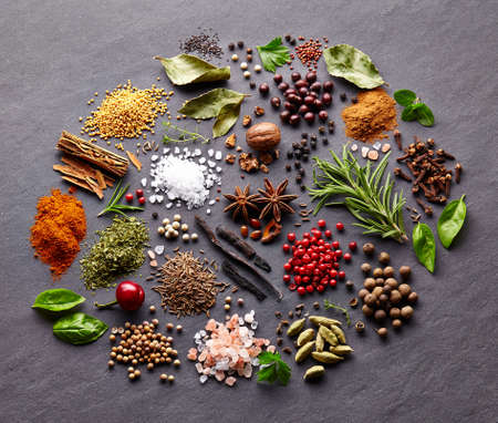 Herbs and spices on a black board Stok Fotoğraf