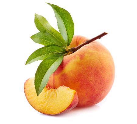 Ripe peach with leaves Banco de Imagens