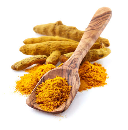 Turmeric root with powder Stock Photo