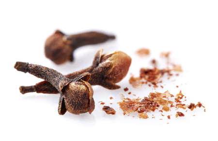 Cloves spices in closeup isolated on a white background Standard-Bild
