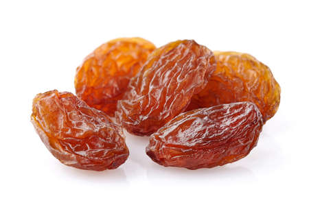 Raisins in closeup on a white background
