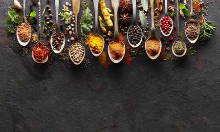 Spices and herbs on  graphite board Archivio Fotografico
