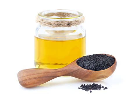 Black cumin oil with seeds Stock Photo