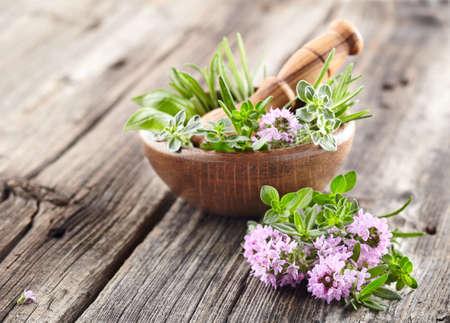 Herbs on wooden board Stockfoto