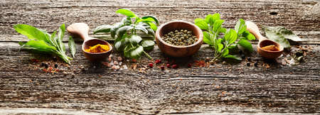 Spices and herbs on wooden board