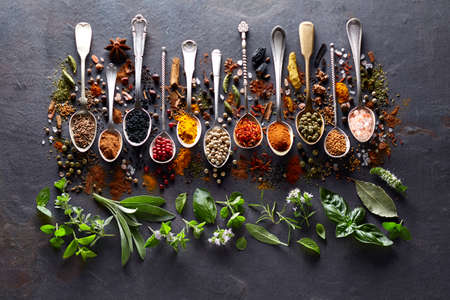 Herbs and spices on black board Banco de Imagens