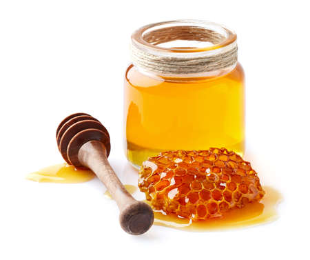 Honey with honeycomb in closeup