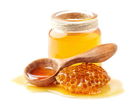 Honey with honeycomb and wooden spoon