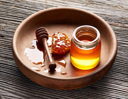 Honey on wooden board Banco de Imagens