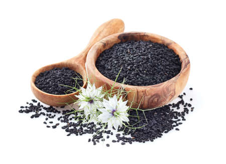 Black cumin seeds on white background