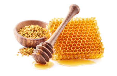 Honey with honeycomb and pollen Stock Photo