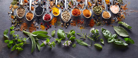 Spices and herbs in closeup on black background Banco de Imagens