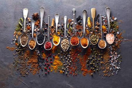 Spices in closeup on graphite board