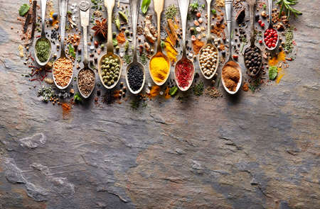 Herbs and spices on black stone