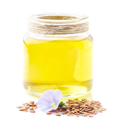 Flax oil with flax seeds in closeup Zdjęcie Seryjne - 128014665