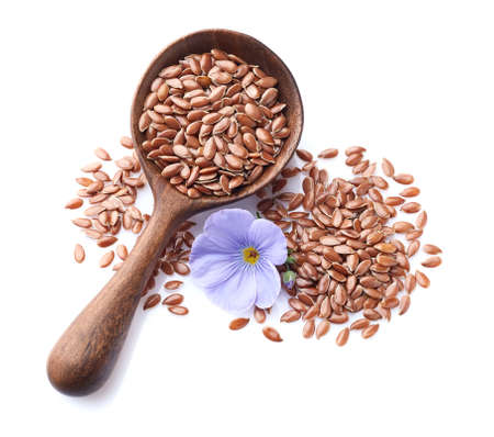 Flax seeds in wooden spoon on white background Zdjęcie Seryjne