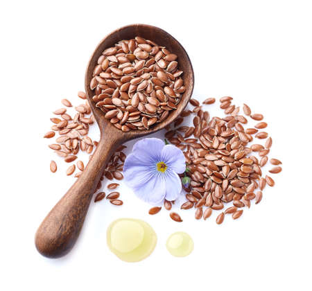 Flax seeds in closeup with drop oil
