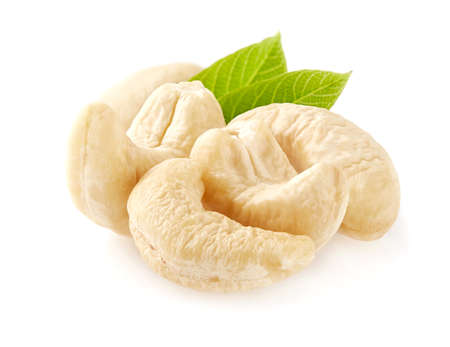 Cashew nuts with leaves in closeup