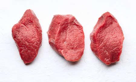 Raw filet mignon on white stone background Stock Photo