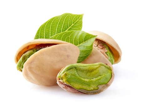 Pistachio macro with leaf on white