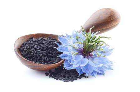 Black cumin seeds with nigella sativa flower on white background Stock fotó