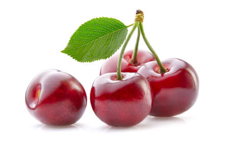 Sweet cherry with leaves on white background Stock fotó