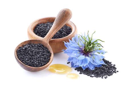 Black cumin seeds with nigella sativa flower on white background Zdjęcie Seryjne