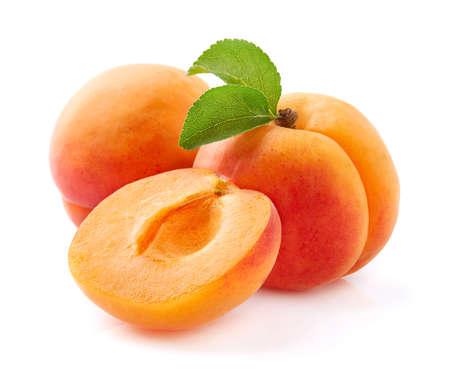 Ripe apricot with leaves in closeup Archivio Fotografico