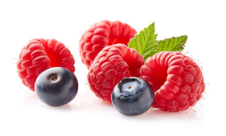 Raspberry and blueberry in closeup on white background