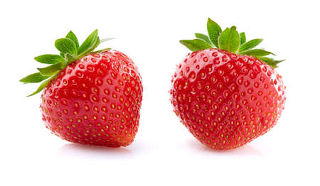 Strawberries in closeup on white background