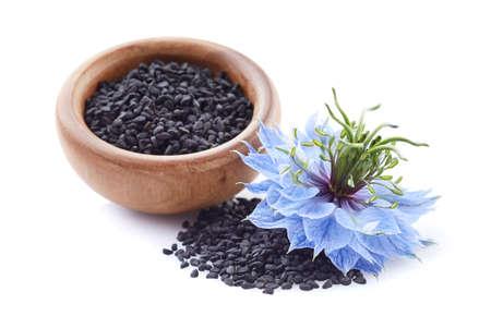 Black cumin seeds with flower on white background Zdjęcie Seryjne