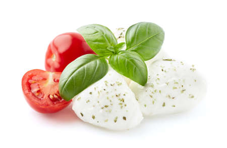 Mozarella with tomatoes and basil leaves