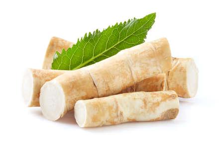 Horseradish root with leaf on white background Stock Photo