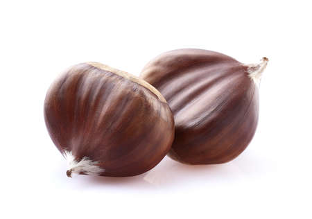 Chestnuts in closeup on white background Stock Photo