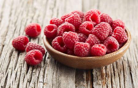 Fresh raspberry on wooden background Stock Photo