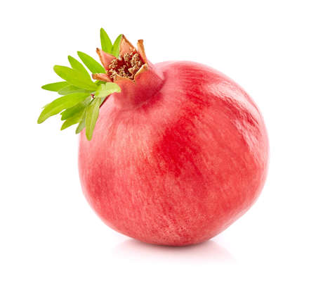 Fresh pomegranate with leaves in closeup