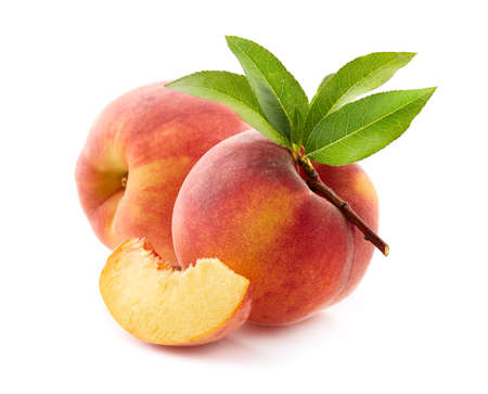 Peaches with leaves on white background