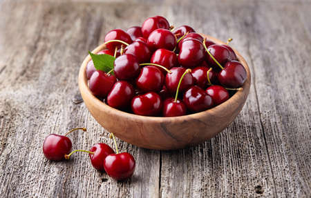 Sweet cherry on wooden background Stock Photo