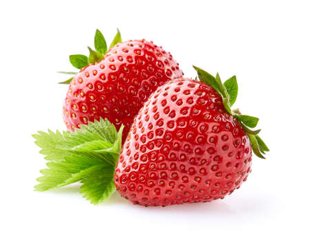 Strawberries in closeup with leaf on white background Stock Photo