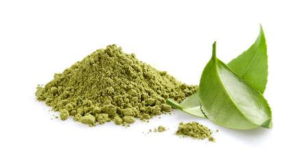 Matcha tea powder with green tea leaves on white background