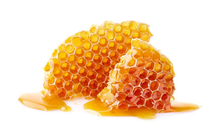Honeycomb with honey drop on white background