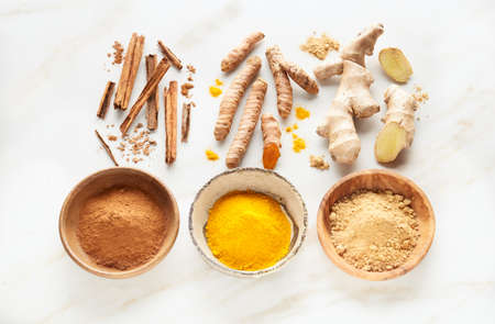 Ingredients for curry masala on marble background