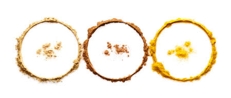 Circle of powder turmeric ginger and cinnamon on white background Stock Photo