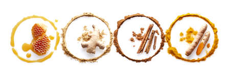 Circle of spices and honey on white background