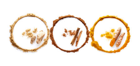 Circle of spices turmeric ginger and cinnamon on white background