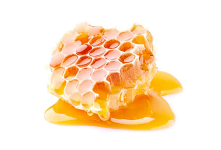 Honeycomb with honey in closeup on white background Stock Photo
