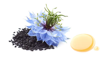 Black cumin seeds with flower and drop oil on white background