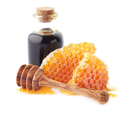 Honeycombs with propolis tincture on white background